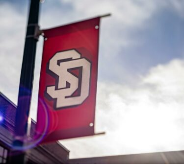 The USD logo hangs on campus.