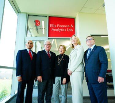 Dean Venky Venkatachalam, Gary Ellis, Sue Ellis, USD President Sheila K. Gestring and USD Foundation President Steve Brown pose outside the new Ellis Lab.