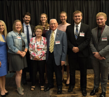 Arnold and Alanna Fenske pose with scholarship recipients at the Sanford School of Medicine scholarship dinner.
