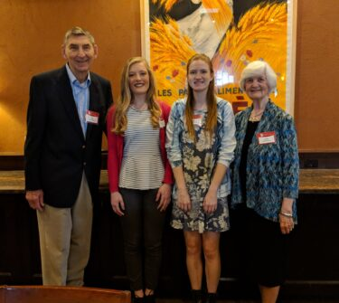 Max and Jeanne Spilde Gonzenbach take a photo with two of the scholarship recipients, Morgan McAllister and Samantha Hyronimus.